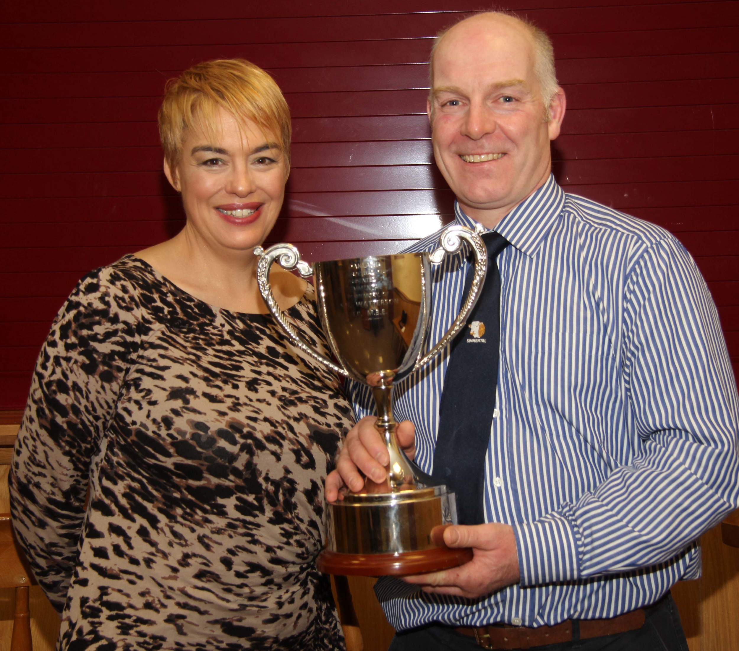Jill and Norman Robson, Doagh, proudly display the SH Watterson Perpetual Cup for the highest priced bull at the club's spring show and sale.