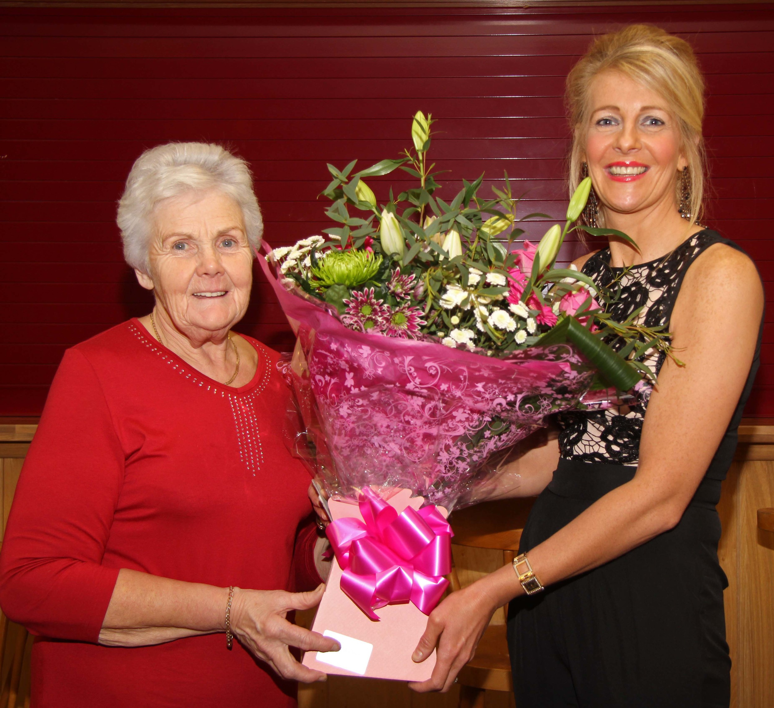 Committee member Thelma Gorman makes a presentation to the chairman's wife Sandra Rodgers.