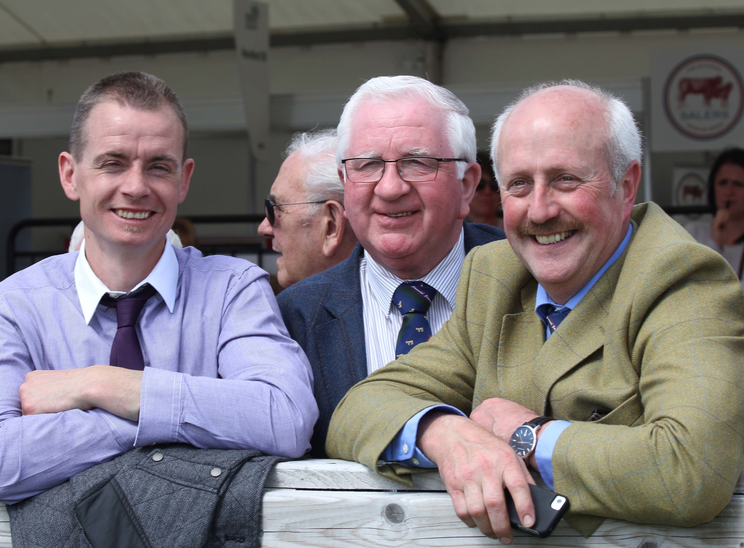 NI Simmental Cattle Breeders' Club chairman Richard Rodgers, enjoys the craic at Balmoral Show with Cecil McIlwaine, Newtownstewart, and Nigel Glasgow, Cookstown.