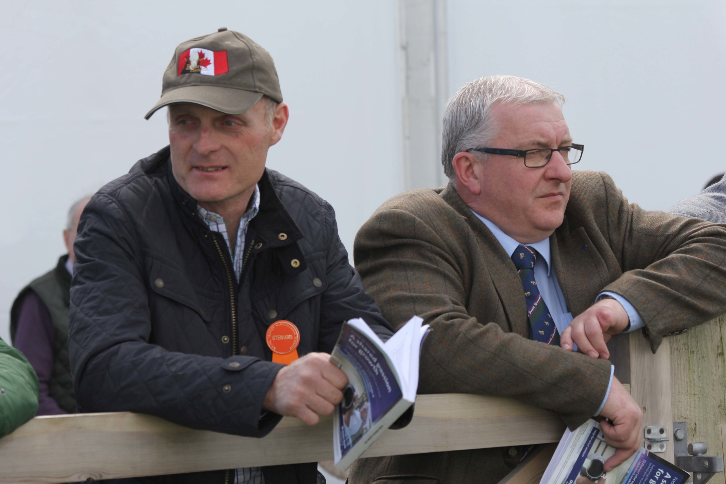 Keeping an eye on the judging at Balmoral Show are Michael Robson, Doagh, and Neil Shand, chief executive of the British Simmental Cattle Society.