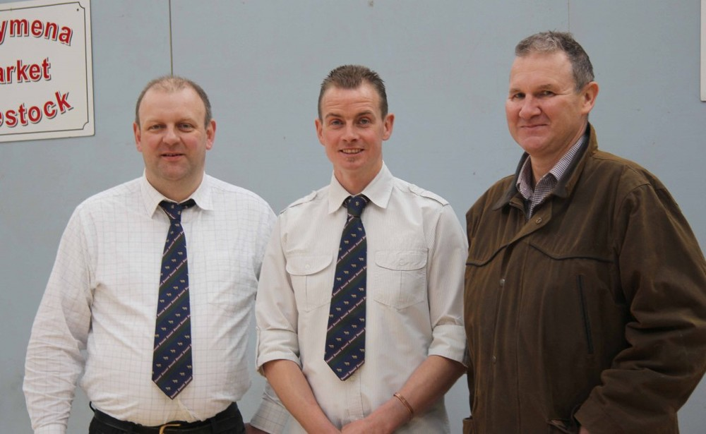 NI Simmental Cattle Breeders' Club chairman Richard Rodgers, centre, with sponsors of its Ballymena show and sale, Matthew Cunning, Connon General Merchants; and Mike Frazer, Edenvale Simmental Herd. Picture: Julie Hazelton