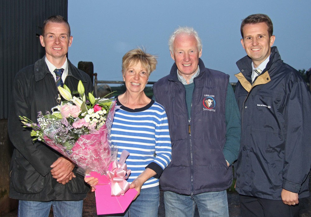 Hosts Leslie and Iris Weatherup, Lisglass Herd, Ballyclare, recieve a token of appreciation from NI Simmental Club chairman Richard Rodgers; and sponsor William Thompson, Bank of Ireland.