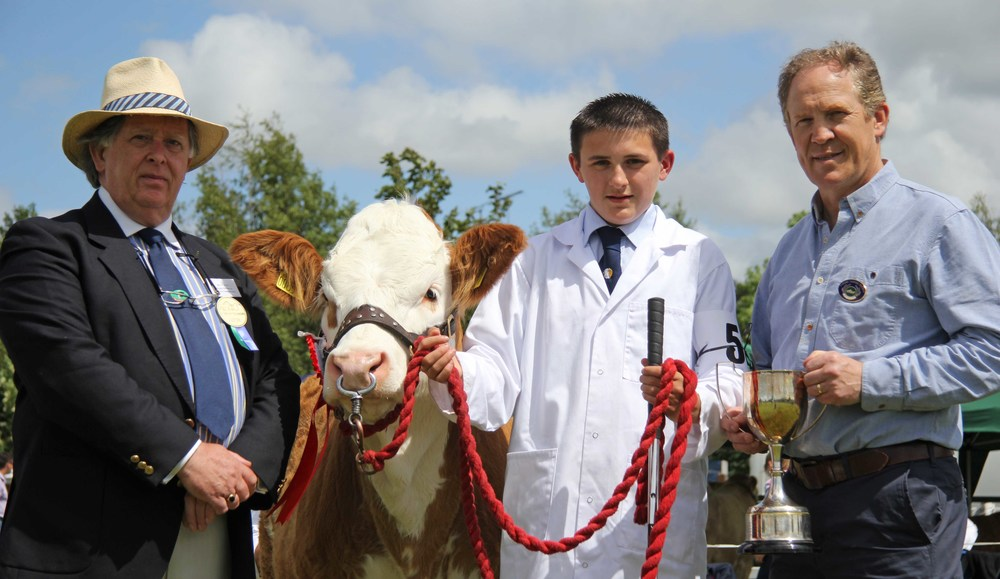 Champion beef young handler at Omagh Show was Jason Whitcroft from Armagh. He recieved the trophy from judge Vaughan Byrne, Dromara; and sponsor Ken Armstrong.