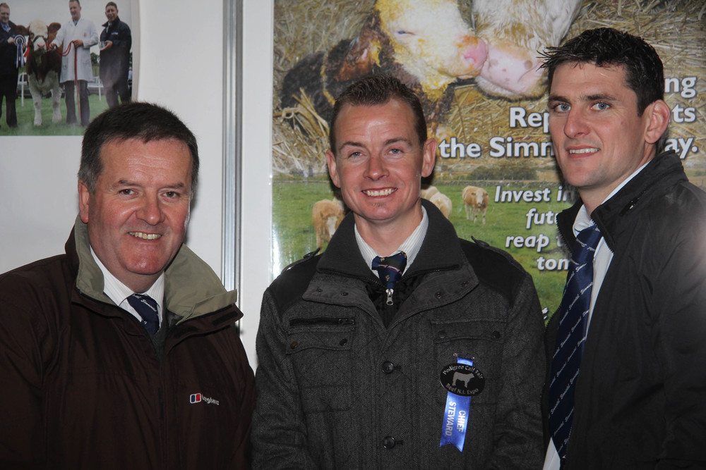 Pictured on the Simmental stand at the Pedigree Calf Fair @ Beef NI Expo are, from left: Robin Boyd, society vice presdient; Richard Rodgers, NI Club chairman; and committee member Conrad Fegan.