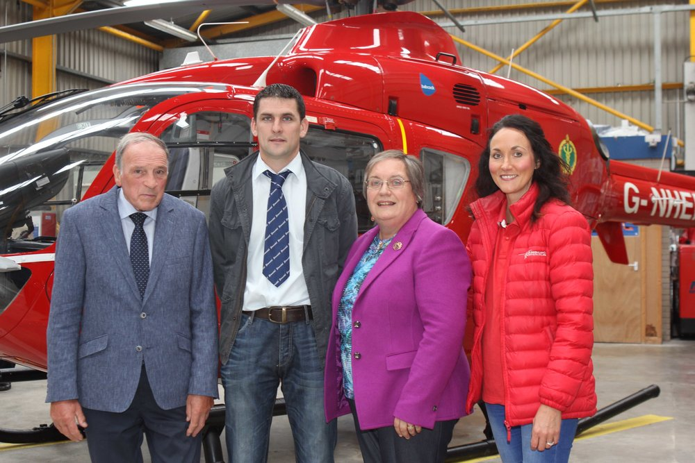 Kenneth and Avril Stubbs, Drumbulcan Herd, are pictured at Air Ambulance NI's operational base at the Maze, with Conrad Fegan, chairman, NI Simmental Club; and the charity's Kerry Anderson.