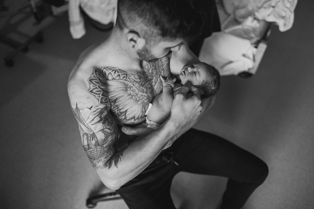 Skin to skin with an inked-up daddy.