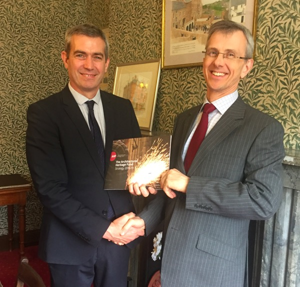 [Photo: The AHF's Ian Morrison presents David Johnston from Gracehill Old School Trust with a copy of our Strategy and confirms our donation of £1,000 towards the Trust's charitable objectives]