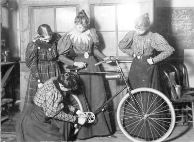 Women_Repairing_Bicycle_c._1895.jpg