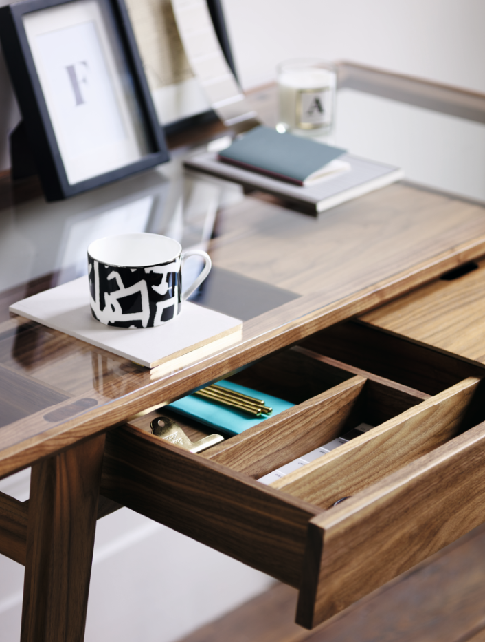 The glass top allows the user to see through into the drawer compartments below