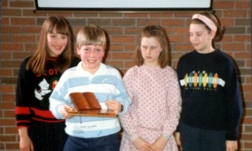 This is me proudly holding the Bible Quiz trophy, sometime in the eighties