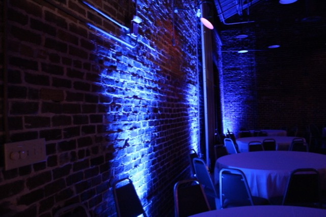 Blue up light on Brick