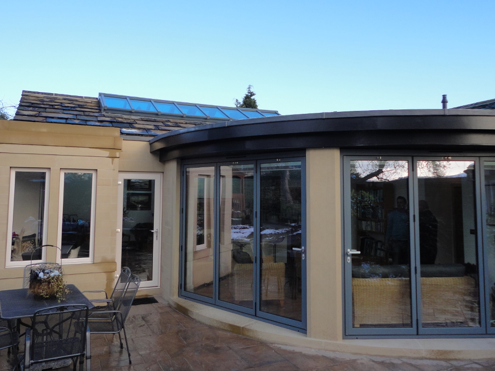 Curved Garden Room And A Kitchen Dining Extension Incorporating Over Ridge Roof Lights In Traditional Lead Cover Finished Newly Quarried
