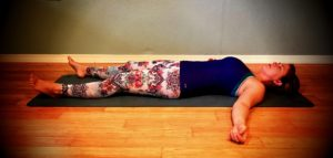 Savasana - Lay on your back and let your body rest completely. If you have any discomfort in your lower back, place a blanket or pillow under your knees.