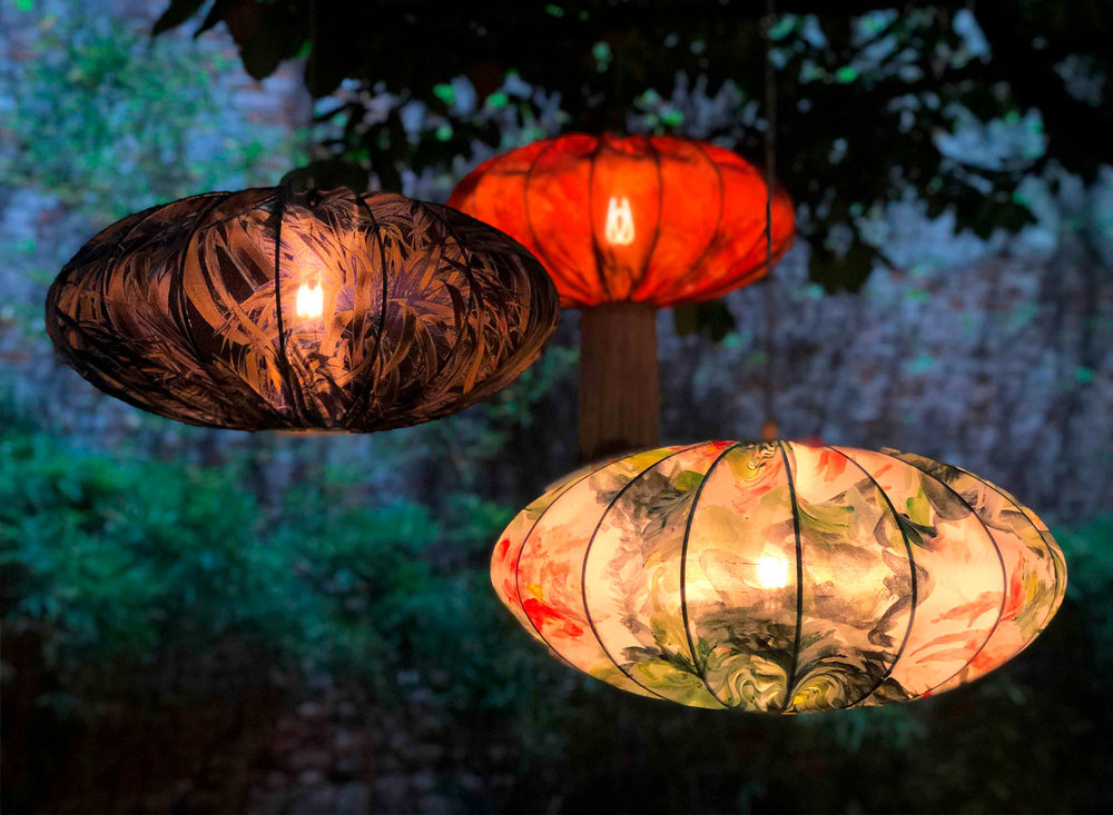 Ume lanterns glowing under the courtyard trees