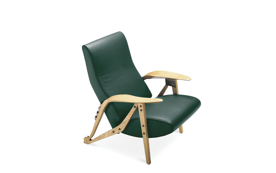 6/7 The Gilda armchair designed by Carlo Mollino in 1954 is now manufactured by Zanotta. It is a chair that reflects the reclining bench seating first seen in early car design.