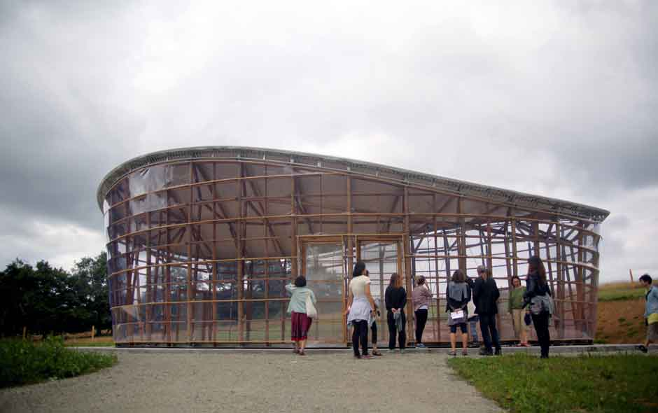 8/11 The bamboo structure built by Simon Velez is now an informal convention hall.