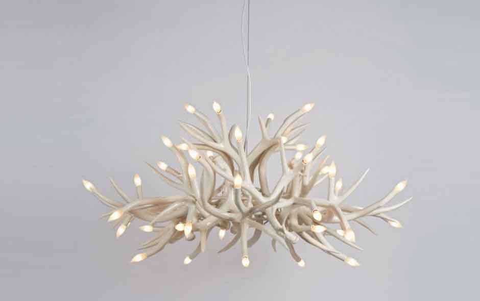 3/4 The Superordinate Antler Chandelier by Jason Miller is constructed of antlers hand made by a ceramicist in South Dakota.
