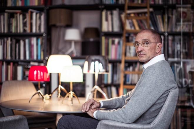 Designer Rodolfo Dordoni with his Lumiere lamps for Foscarini.