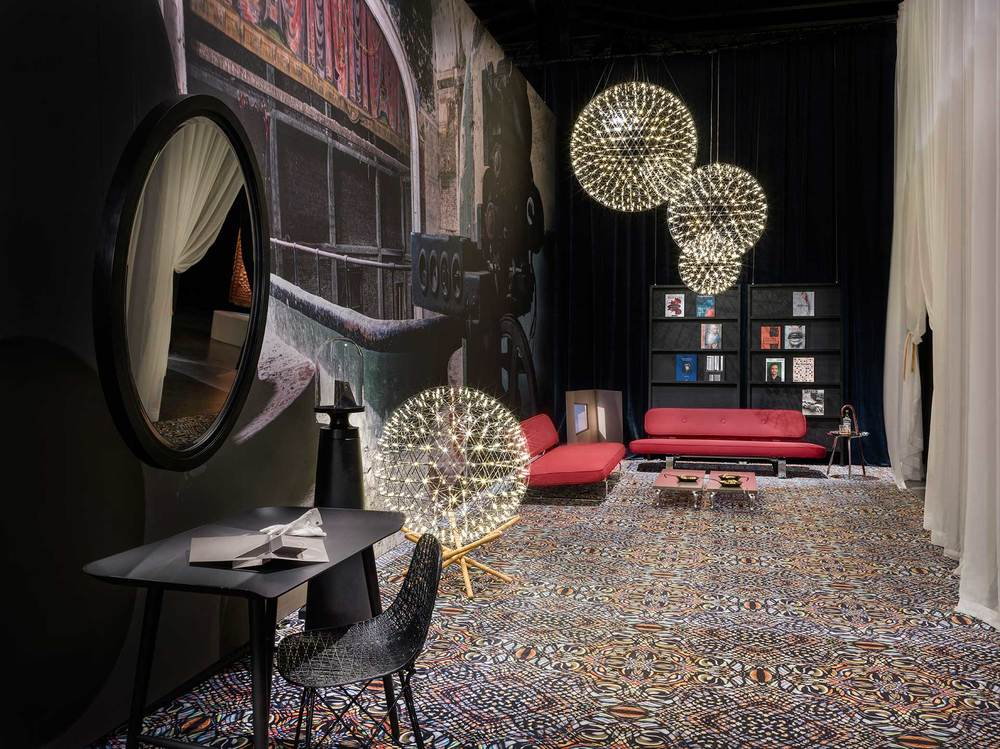A cluster of Moooi's Raimond lights sparkle against the darkness in Moooi's 2016 Milan exhibit. Photo Andrew Meredith for Moooi.