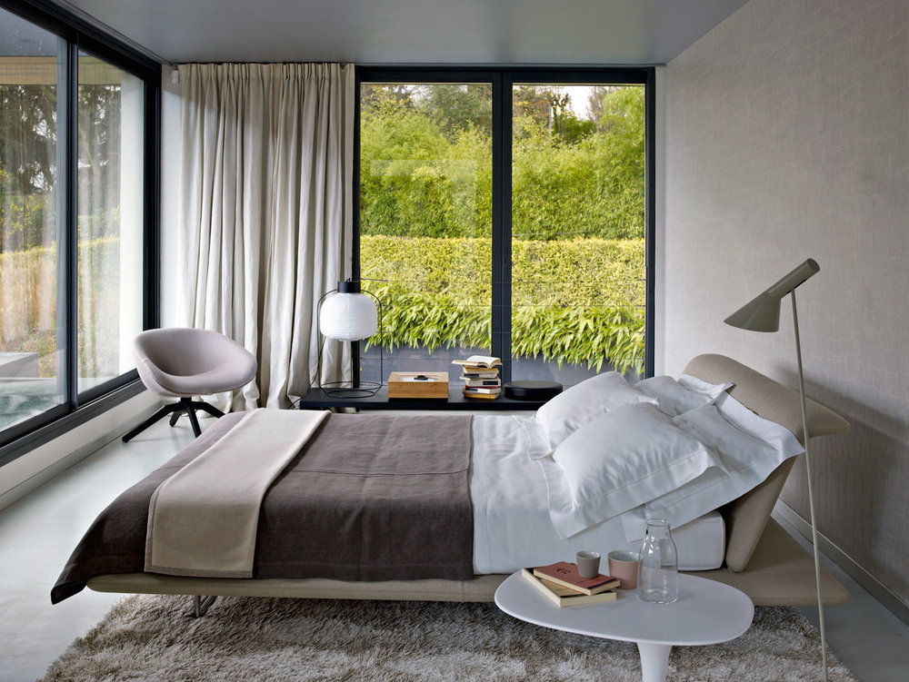 The B&B Italia Siena bed is the star of this contemporary bedroom design.