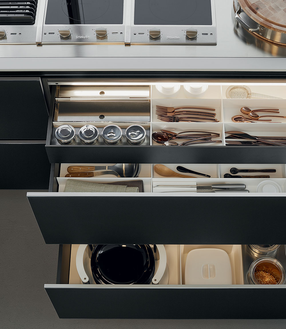 The  Twelve kitchen system  by Carlo Colombo features a 12mm slim profile and push and pull servo drive opening mechanism.