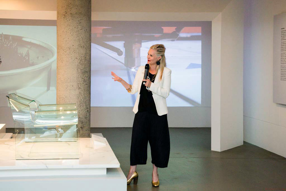 Simone LeAmon, Curator, Contemporary Design and Architecture, with the Ghost chair by Cini Boeri and Fiam. Photo courtesy NGV.