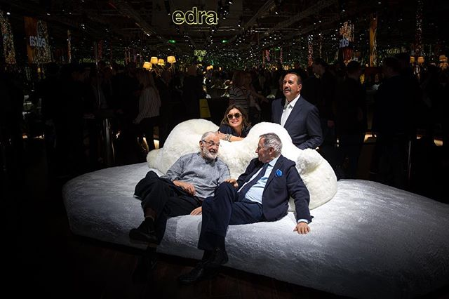 Designer Francessco Binfaré (left) reclining on his new Pack and Chiara sofa at the Edra installation during the Milan Furniture Fair this year.