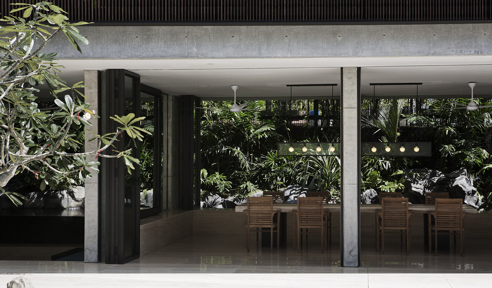 The Courtyard House balances periphery and core, open and private, and lush tropical foliage acts as a buffer to neighbours and a temper to the western sun.