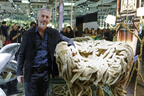 Humberto Campana with the Grinza armchair at the Milan Furniture Fair.