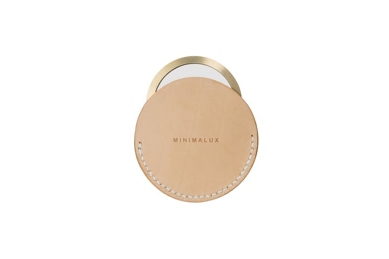 Made from precision machined solid brass and crystal clear mirror glass, the pocket mirror comes with or without the tan leather sleeve that is stitched with waxed linen thread.