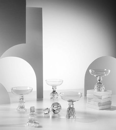 The Half-Cut collection of champagne glasses cleverly reinterprets the ornate form of a crystal decanter stopper. The collection comes in round, square, dome and cone forms.
