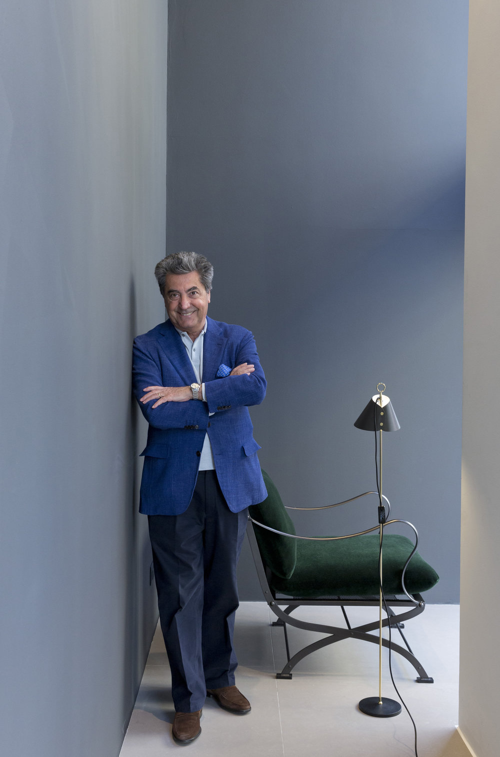 Antonio Citterio at the B&B Italia showroom looking happy on day one of Milan Design Week.