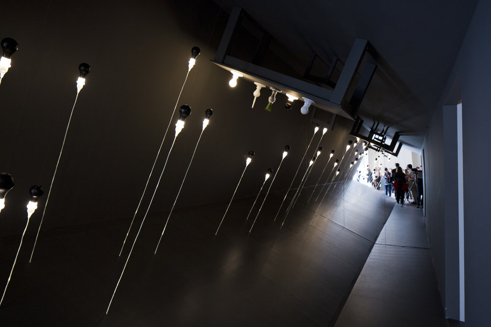 The 'Reverse Room' installation at the Foscarini Brera Space featuring 'The Light Bulb Series' by James Wines.