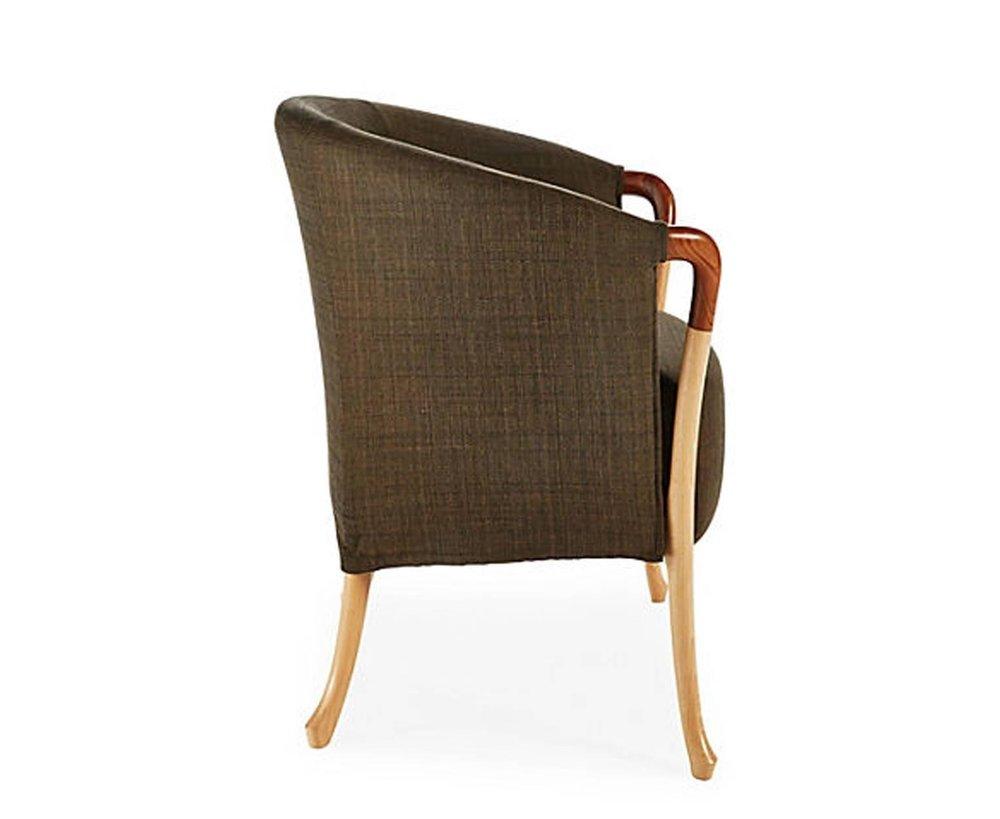 The Progetti chair designed by Carlo Giorgetti and the Giorgetti design team in 1987.