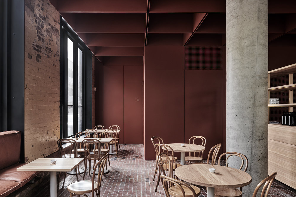 Leather, brick, concrete, timber and steel, painted in an earthy red oxide, provide a material palette that is stripped back to the essential elements. Photo Tom Blachford.