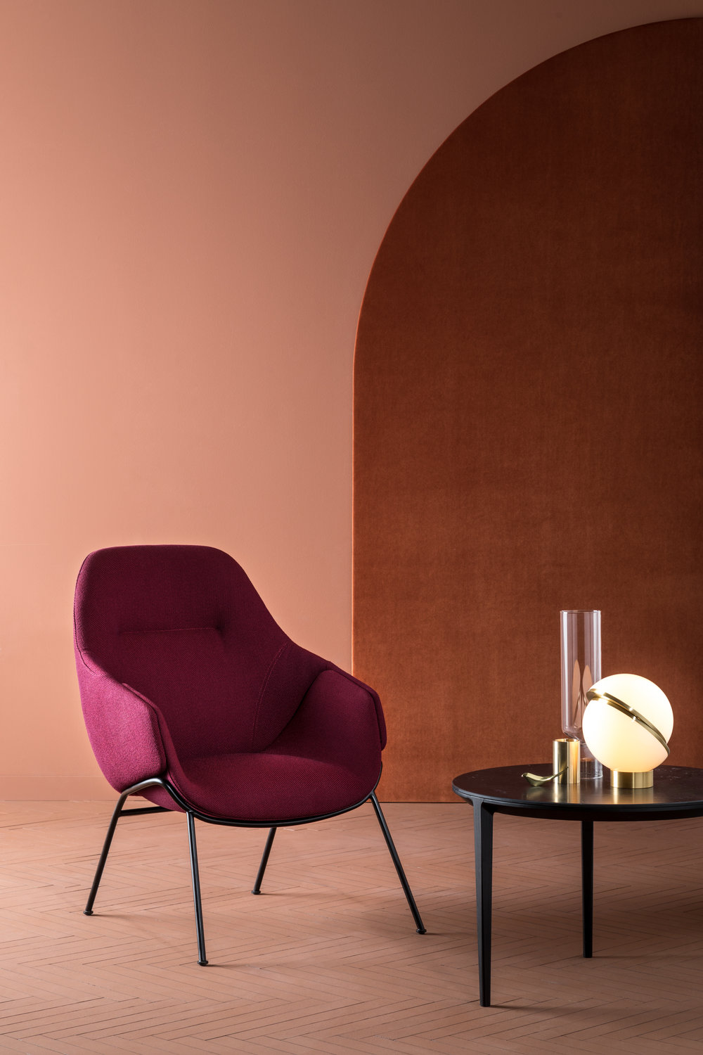The Anita armchair re-articulated, the new high-back version with its simple rod base projecting 1950s glamour.