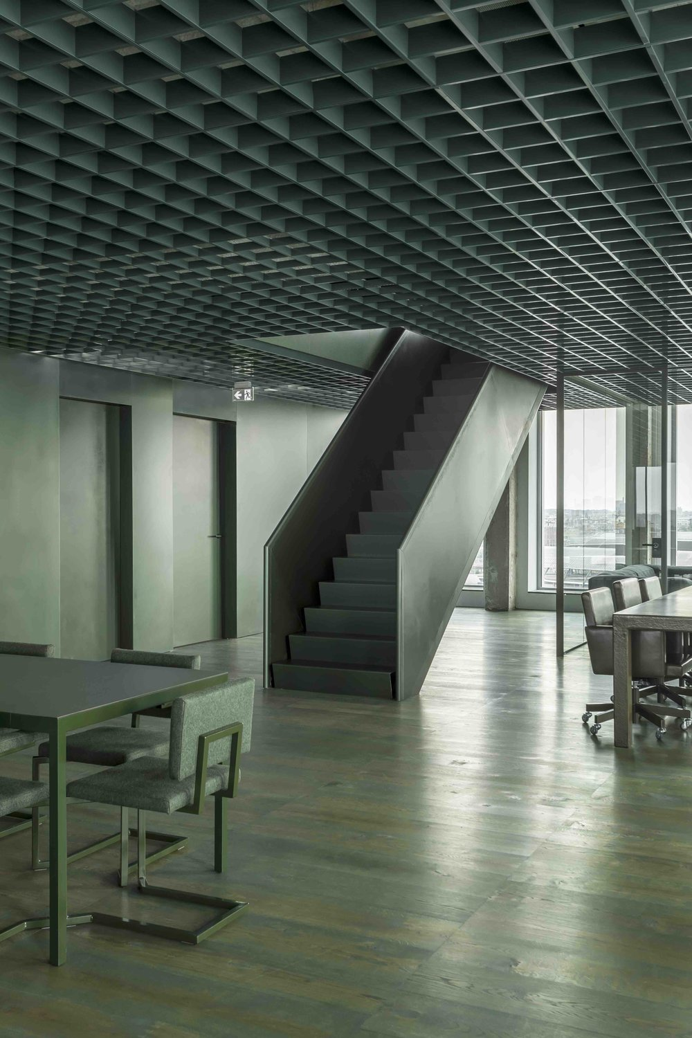 The offices for Sony Music Entertainment A'DAM (top and above) transformed a 1960s architectural icon. with the interior core resembling the inside of an amplifier and the colour and material palette of grey and green and 'nothing in between'.