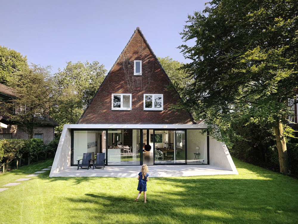 The SH House in Amsterdam was all about connecting with the garden, maintaining the overall shape and integrity of the original building while creating an open floor plan that focuses on views outside.