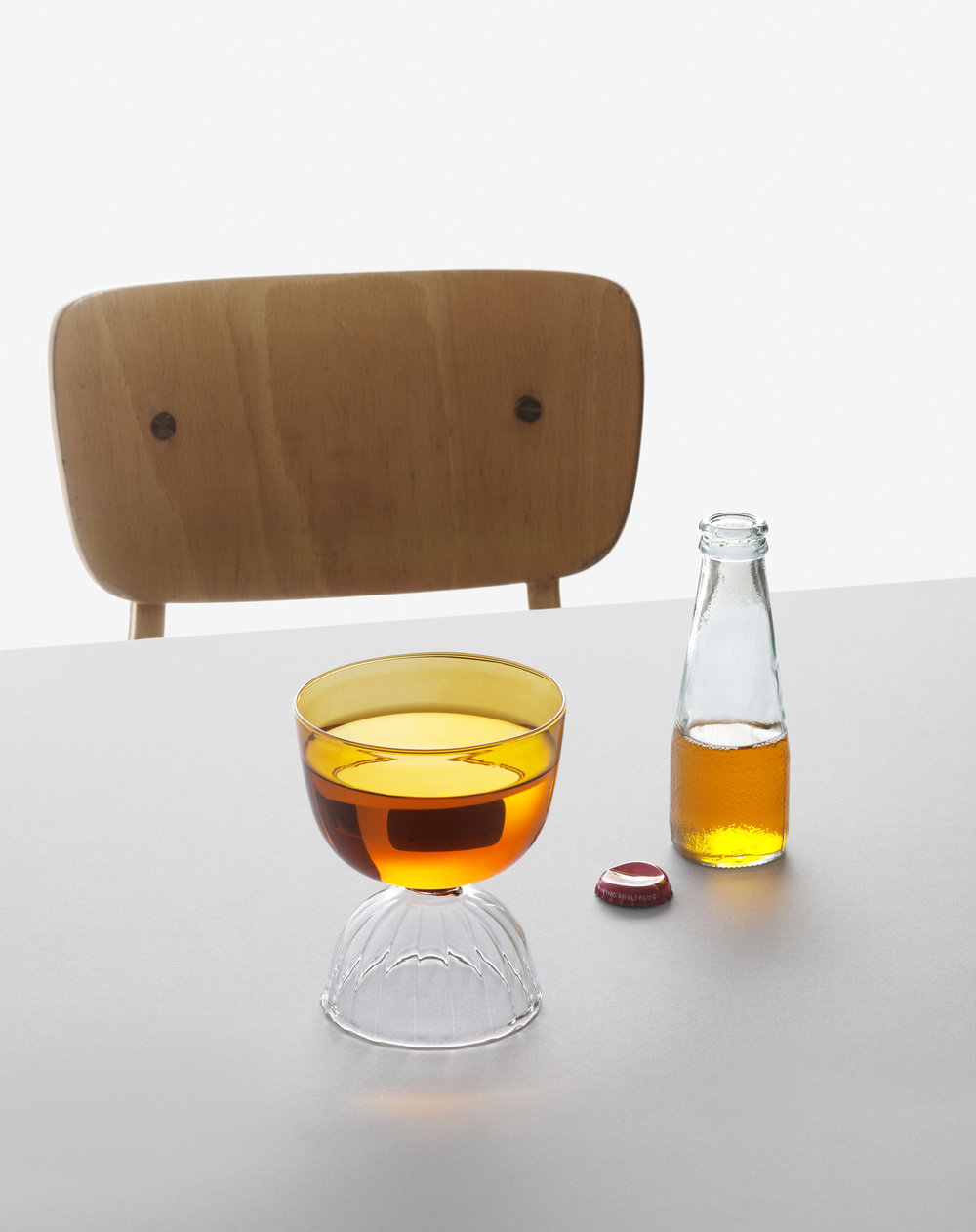 The Totu collection by Misto-o for Ichendorf Milano juxtaposes glass elements and colours including deep amber using borosilicate glass hand-blown locally in Italy. Photo © Alberto Strada.