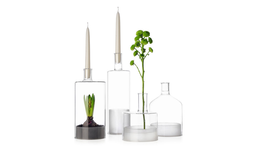 The Tokyo collection designed by Misto-o for Ichendorf Milano comprise two drinking glasses with sandblasted bases, a tall bottle and a water pitcher with circular handle, oil dispenser and terrariums.