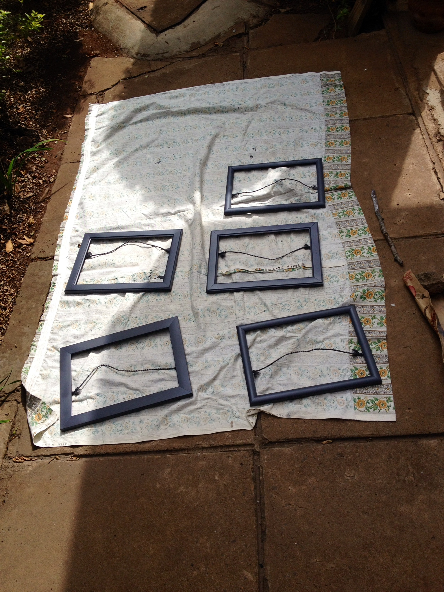 Frames drying outside after being spray painted