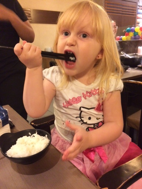 Mikayla tried so hard to eat with chop sticks like the rest of us, but it she just wasn't coordinated enough.