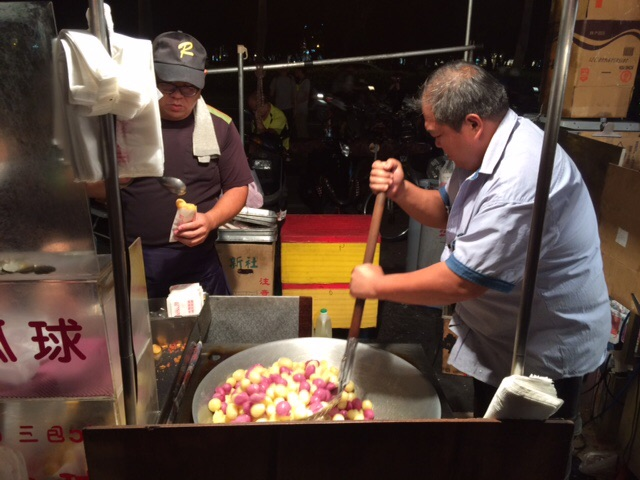 We loved how inexpensive street food is in Taiwan. We mostly ate out, which was cheaper than grocery shopping. Our favorite place to go was a night market just down the street from our apartment. Here, a vendor makes fried sweet potato balls — delish!