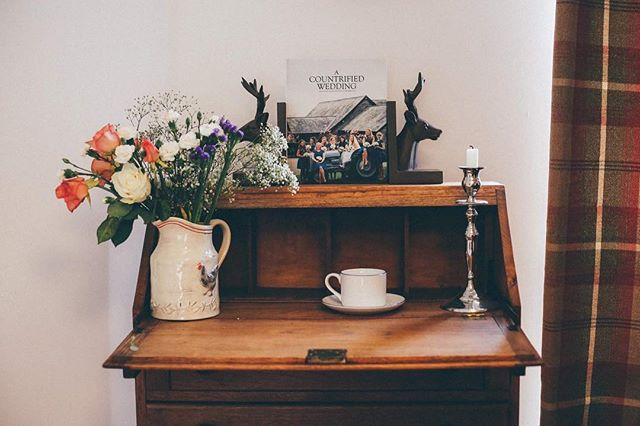 #acountrifiedwedding . . . . . #wedding #photography #destinationwedding #flowers #folklife #tea #tweed #deer #countryfashion #candle #bureau #book