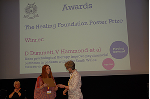 Dr Danielle Dummett receiving poster prize 2015