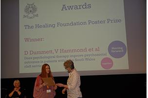 Dr Danielle Dummett receiving poster prize 2015