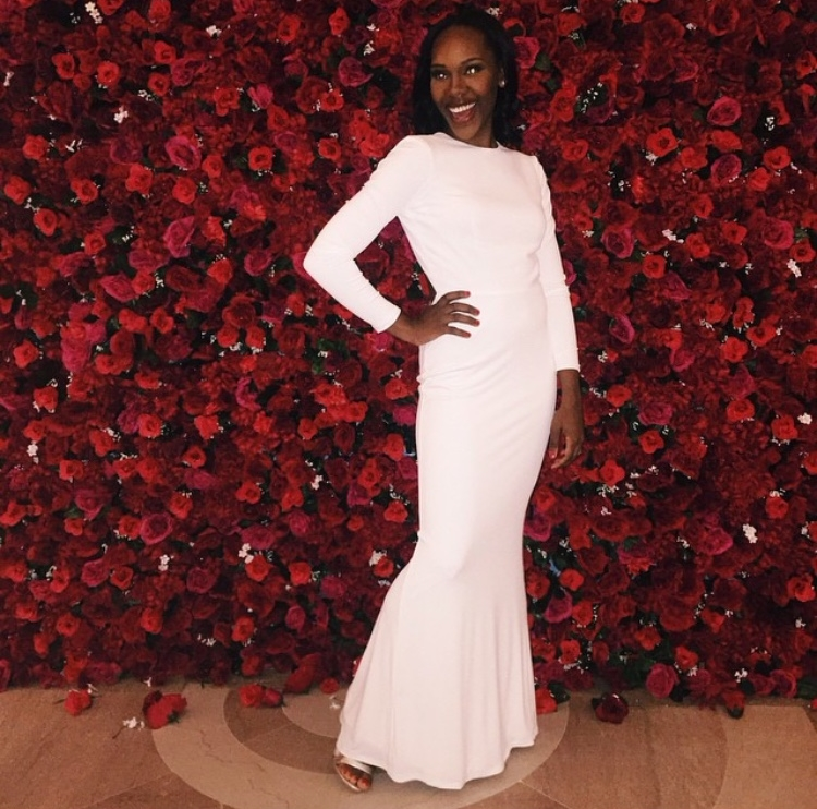 Guest posed for photos on the hand-made 8 x 12 ft Rose Wall made of Silk Flowers.