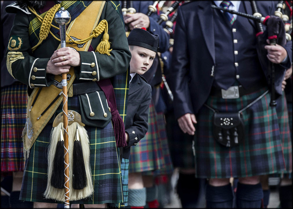 Young Piper waits to perform at the Braemar Highland Gathering, Scotland