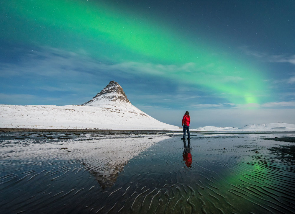 Selfie, self portrait under the aurora borealis at Kirkjufell, Iceland
