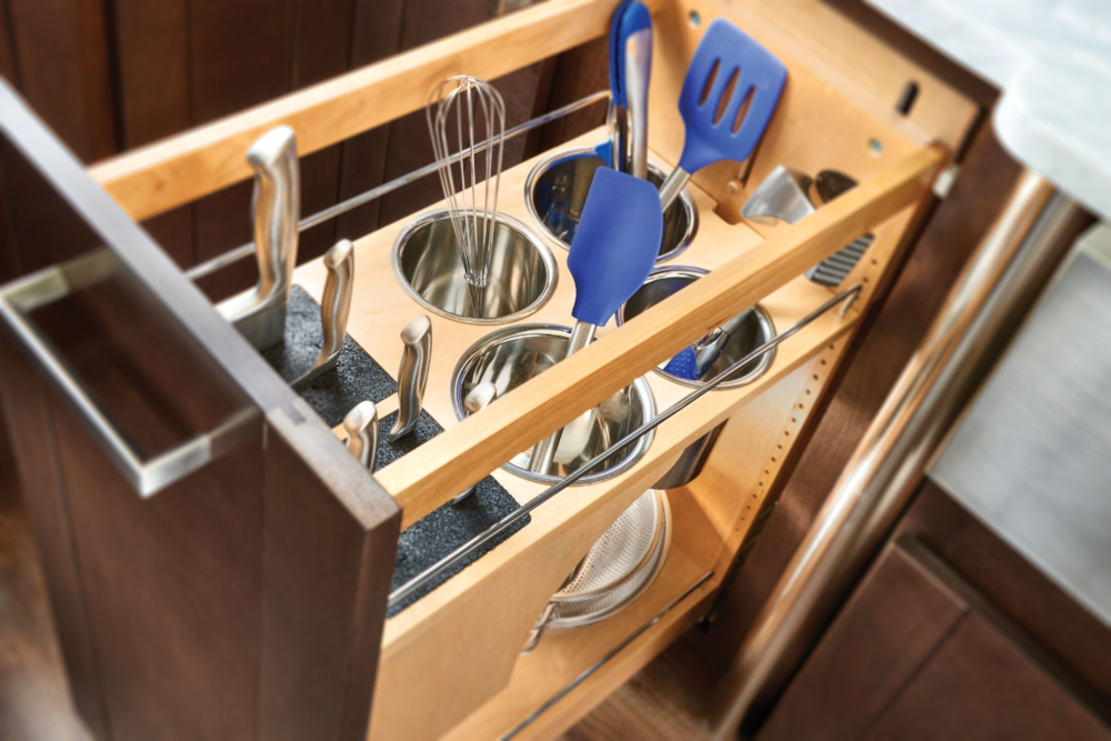 This one base cabinet pullout organizes knifes, utensils, bowls and even small appliances.